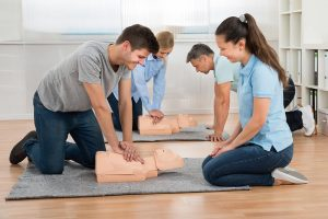 Why do companies need to consider getting first aid training for employees